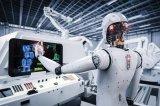 2021年会有智能机器人实体负责监督工业机器人,...