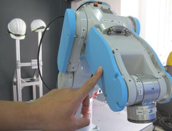 人机共工新规范再翻新 协作机器人正式走出围篱