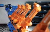 国产工业机器人从中下游包抄四大家族,实现超越指日...