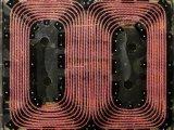 橡树岭国家实验室利用这些线圈产生磁场,为电动汽车...