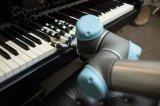 科学家发明3D打印机械手,可以弹钢琴