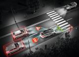 欧司朗智能车灯投影解决方可以在车前或车后方投影出警告标识