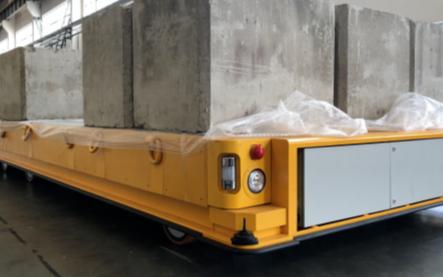 国内外首套全新的差速全向轮式车:航天智造200吨重载移动机器人